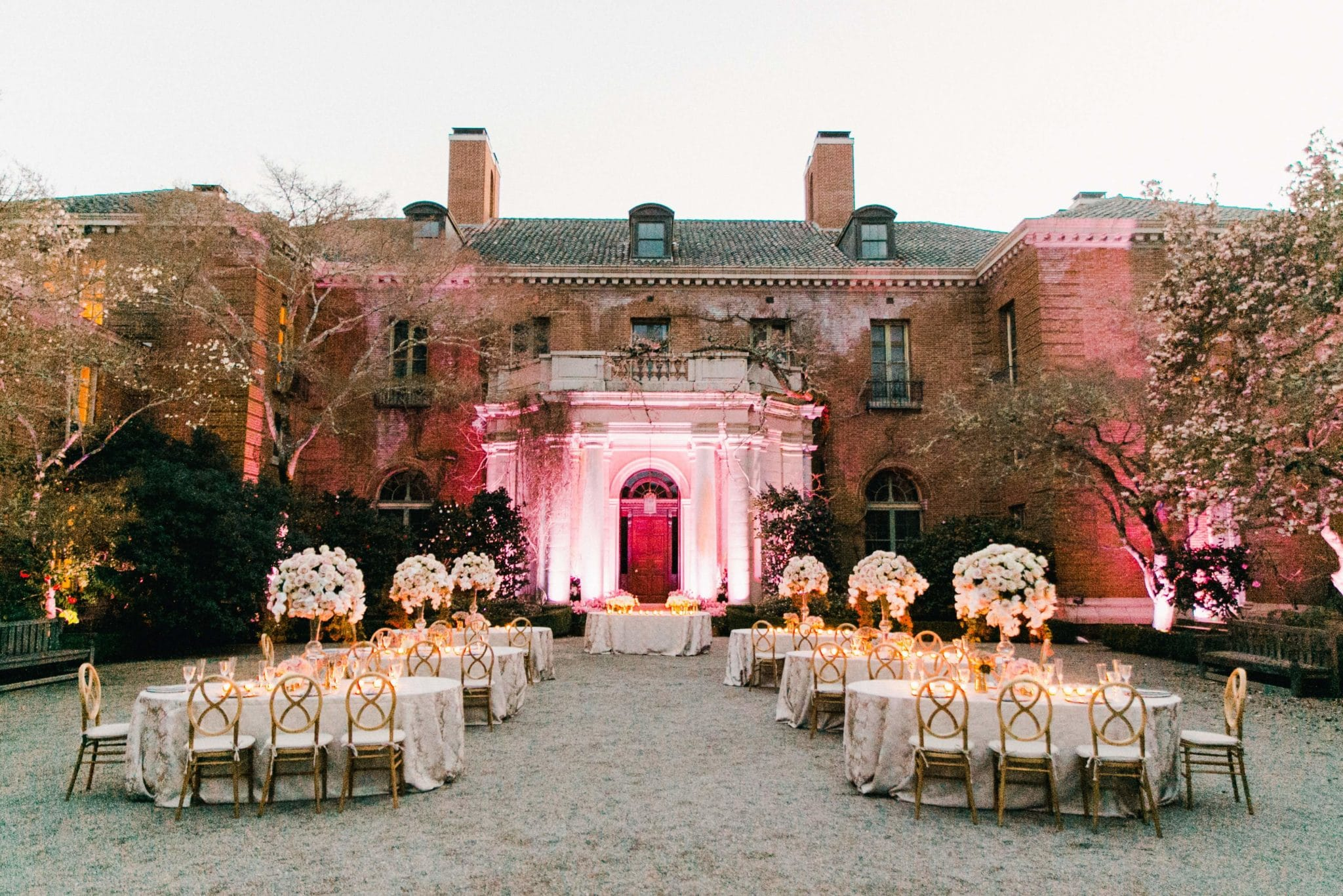 An elegant wedding reception dinner in the Entry Courtyard.