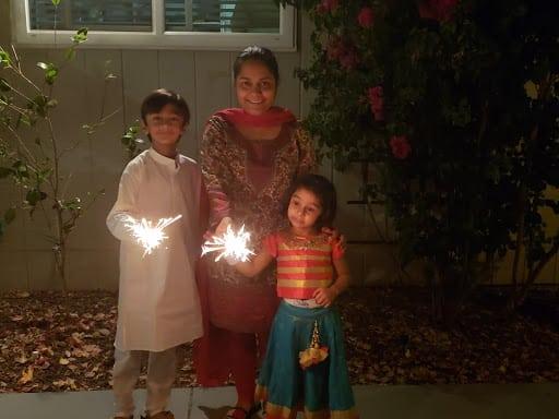 Priya and her children celebrating Diwali in 2019.